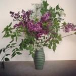 Green Vase with Arrangement.  Flowers & Photo by Byrd Collective